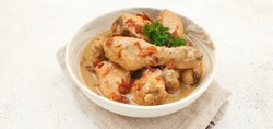 Indonesian Food : Opor Ayam or Chicken Curry. Chicken cooked in coconut milk and spices. It is served to celebrate Eid Al Adha and Eid Al Fitr. Isolated and copy space on white background.