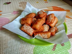 Indonesian fried bread called Roti/kue Bantal or with another famous name ODADING in dark foodphotography style.