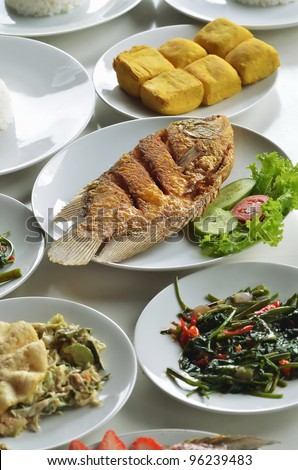 Indonesian fried fish menu served with refreshing healthy tropical vegetables, rice, tofu (soybean curd). This menu usually served for lunch
