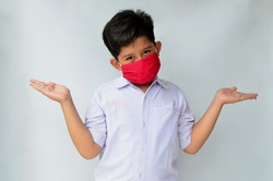 Indonesian male students wearing masks with confused expressions when going to school