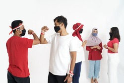indonesian people elbow shake hand during independence day due to corona virus outbreak