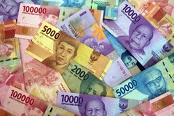 Indonesian rupiah the official currency of Indonesia. Bank Indonesia notes background.