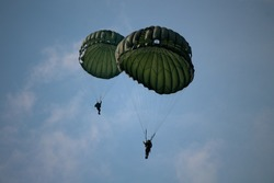 Indonesian special forces paratrooper jumping from a plane