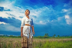 indonesian woman posing on a field