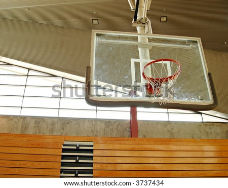 Indoor basketball court with smudge marks on the board