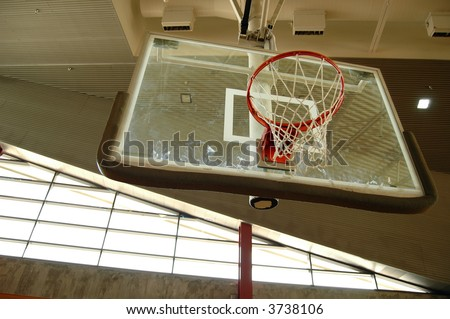 Indoor basketball hoop with a grungy looking wall as a backdrop