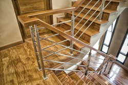 Indoor Concrete Staircase with wood handrail in the building