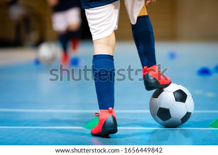 Indoor futsal soccer players playing futsal match. Indoor soccer sports hall. Futsal players kicking match. Futsal training dribbling drill. Sports background. Indoor soccer league. Stock photo ©