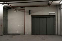 Indoor garage door, with a security mechanism and ventilation duct above it