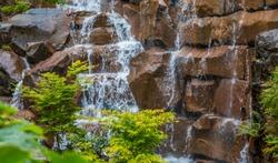 Indoor Garden Waterfall over Brown Stones