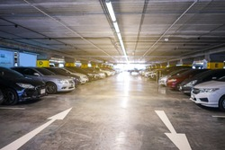 Indoor parking lot building blurred background and bokeh light