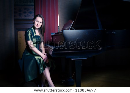 indoor portrait of a young female piano player