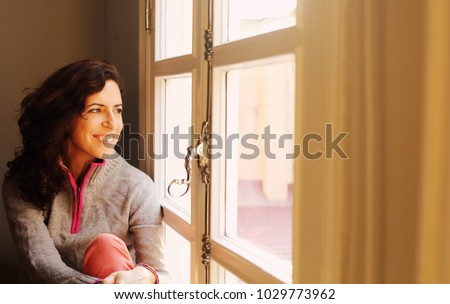 Indoor portrait of beautiful 45 years old woman next to the window Photo stock ©