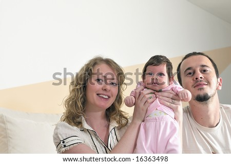 indoor portrait with happy young family and  cute little babby #16363498