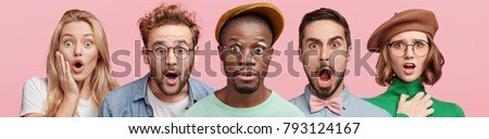 Indoor shot of different people stand in row, express great surprisment and amazement as hear unexpected news, stare at camera with bugged eyes, isolated over pink background. Facial expressions