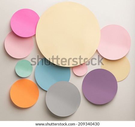 Indoor shot of paper cutout circles in various colours.