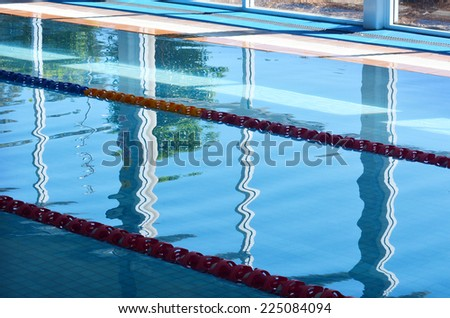 Indoor swimming pool. Background texture. concept photo water, sport, swimming.