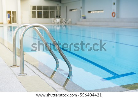 Indoor swimming pool with stair in a building #556404421