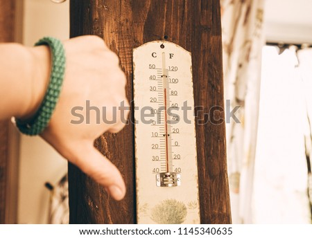 Indoor thermometer show over 30 degrees celsius, heat wave concept in summer.