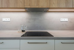 Induction cook top on worktop of contemporary kitchen