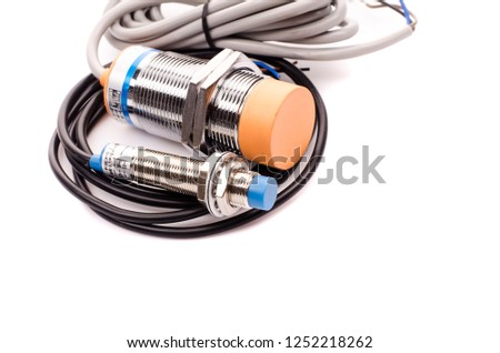 Inductive proximity sensor or proximity switch installed on the machine. #1252218262