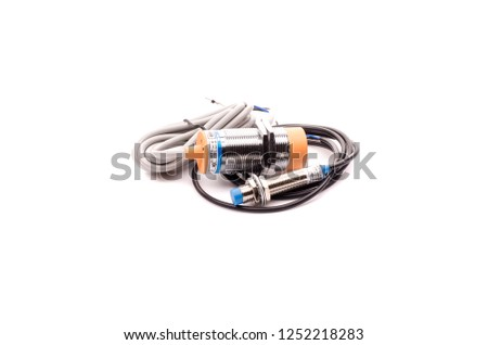 Inductive proximity sensor or proximity switch installed on the machine. #1252218283