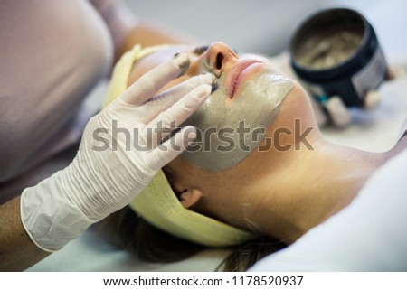 Indulging in a deep cleansing masque. Woman in spa center with facial mask. Close up. Copy space.