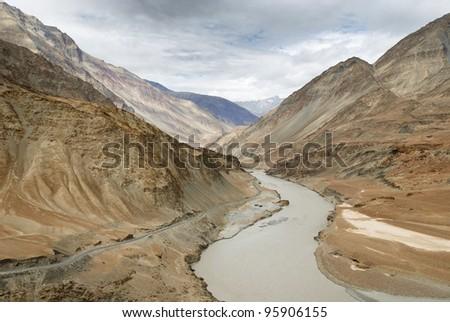 Indus river runs through an arid landscape in Ladakh