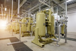 Industrial air compressor systems with equipment machinary, tank, pump, gauge, valve, electric supply, and piping systems into the supply manufactering process of the plant