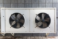 industrial air conditioner outdoor unit with two fans closeup