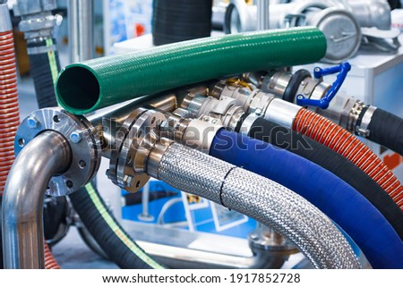 Industrial and hydraulic hose. Standard hose products for the agricultural, food processing, manufacturing, and heavy equipment markets, and offers customers complete hose assembly customization. Stock photo ©