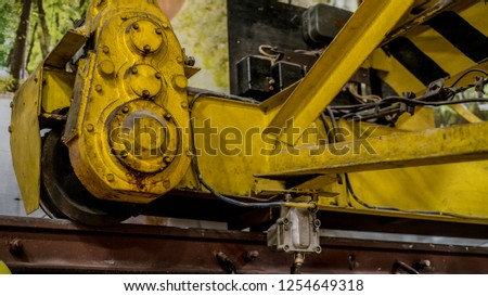Industrial and technological objects. Beautiful view and background to a complex and incomprehensible metal mechanism and device. #1254649318
