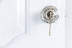 Industrial architecture Installing locking knob with key at the door inside the house by locksmith
