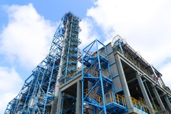 Industrial area of the refinery. Oil refining equipment and pipelines of the refinery.