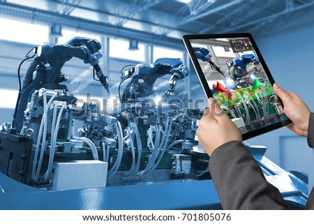 Industrial 4.0 , Augmented reality concept. Hand holding tablet with AR service , maintenance application and calling technician for check destroy part of smart machine in smart factory background