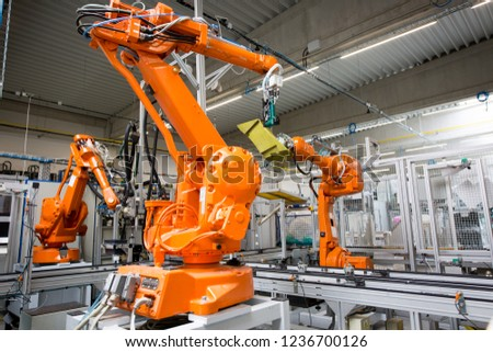 Industrial automatic robot arms in the production line, inteligent factory industry