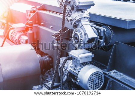 Industrial automotive machine tool equipment close up, abstract industry manufacturing metalwork background, blue toned