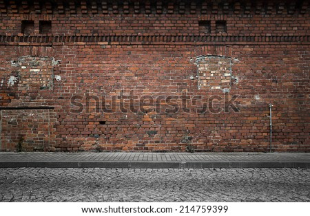 Industrial background, empty grunge urban street with warehouse brick wall #214759399