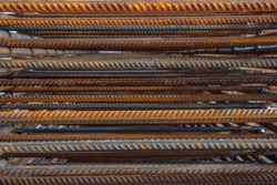 Industrial background. Rebar texture. Rusty rebar for concrete pouring. Steel reinforcement bars. Construction rebar steel work reinforcement. Closeup of Steel rebars.