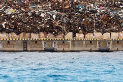 Industrial background, scrap metal. Pile of scrap metal ready for loading at the port