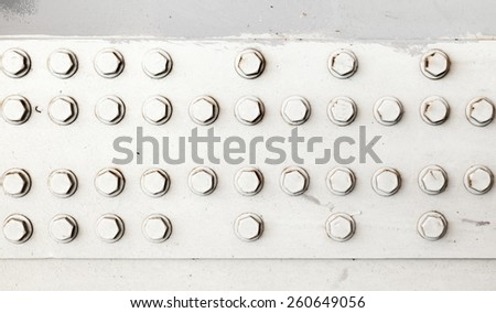 Industrial background texture, abstract pattern of white bolts and nuts