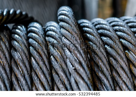 Industrial background with a coiled steel cable. Foto d'archivio ©