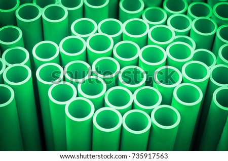 Industrial background with Green plastic pipe for hot water