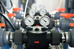 industrial barometers and water pipes in boiler room