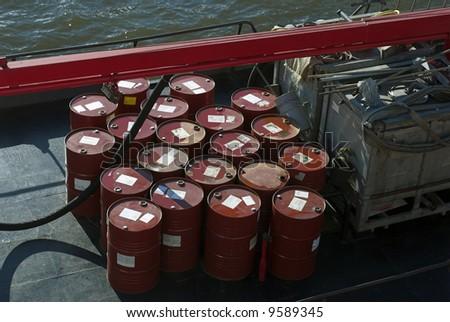 Industrial barrels stored outside on ship deck