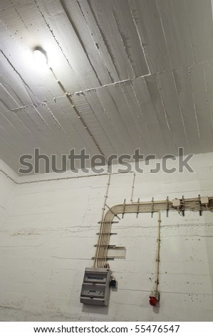 Industrial basement wall with wiring and breaker box