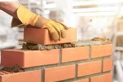 Industrial bricklayer installing bricks