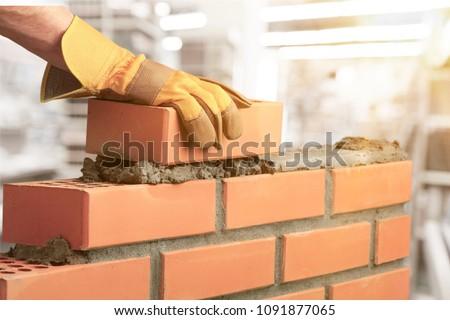 Industrial bricklayer installing bricks