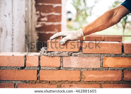industrial bricklayer worker...