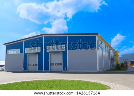 Industrial building against the blue sky. Factory